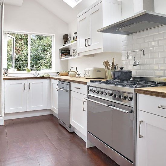 White kitchen with wooden flooring   Decorating