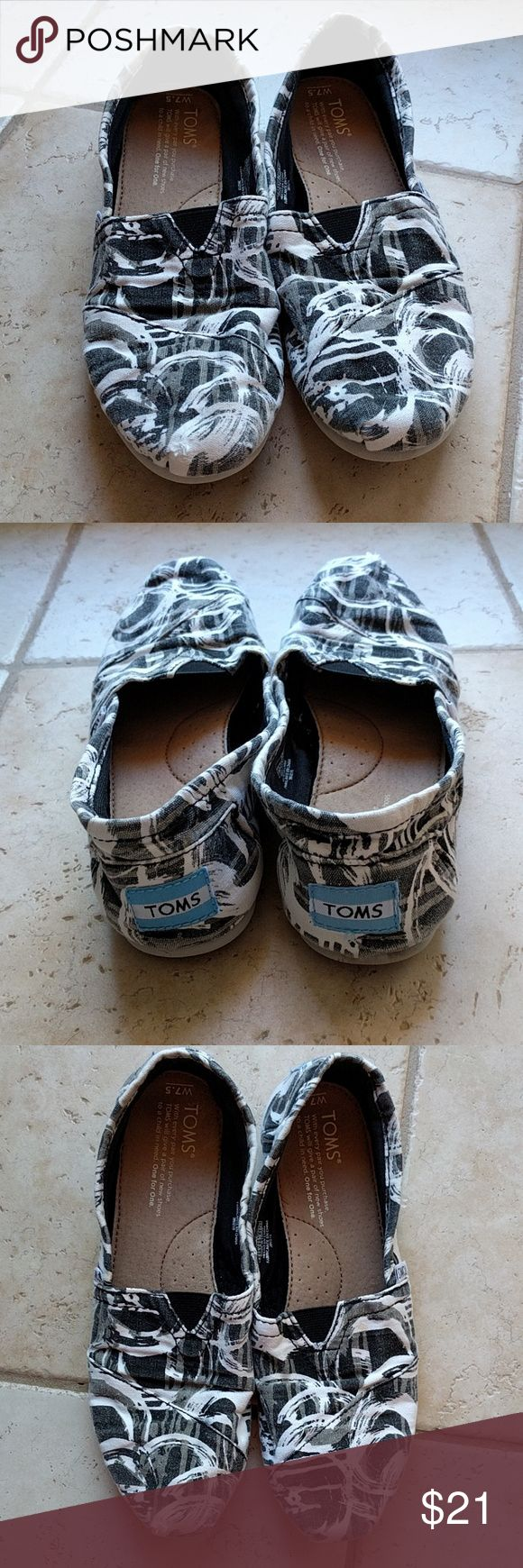 Toms with Fun Black, Gray, & White Pattern Good used condition, freshly washed Toms. No funk or smells, insoles are clean. Tad bit of wear on the toes and a bit of fading. Tiny stain on top of the right Tom the size of a pin head. Looks like a drop of coffee hit it. TOMS Shoes Flats & Loafers