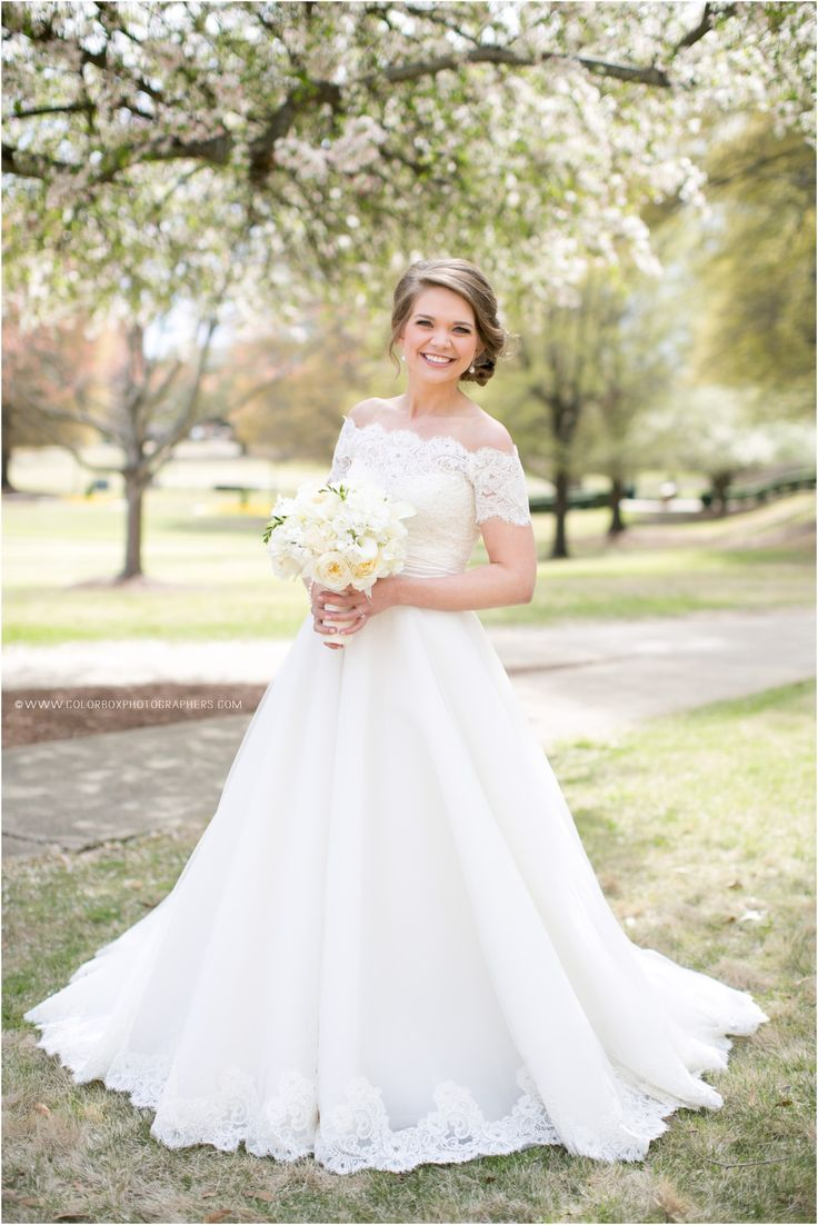"Real bride Marjorie is all smiles on her wedding day! Anne Barge ""Grace"" wedding gown with lace bolero jacket. Colorbox Photographers"