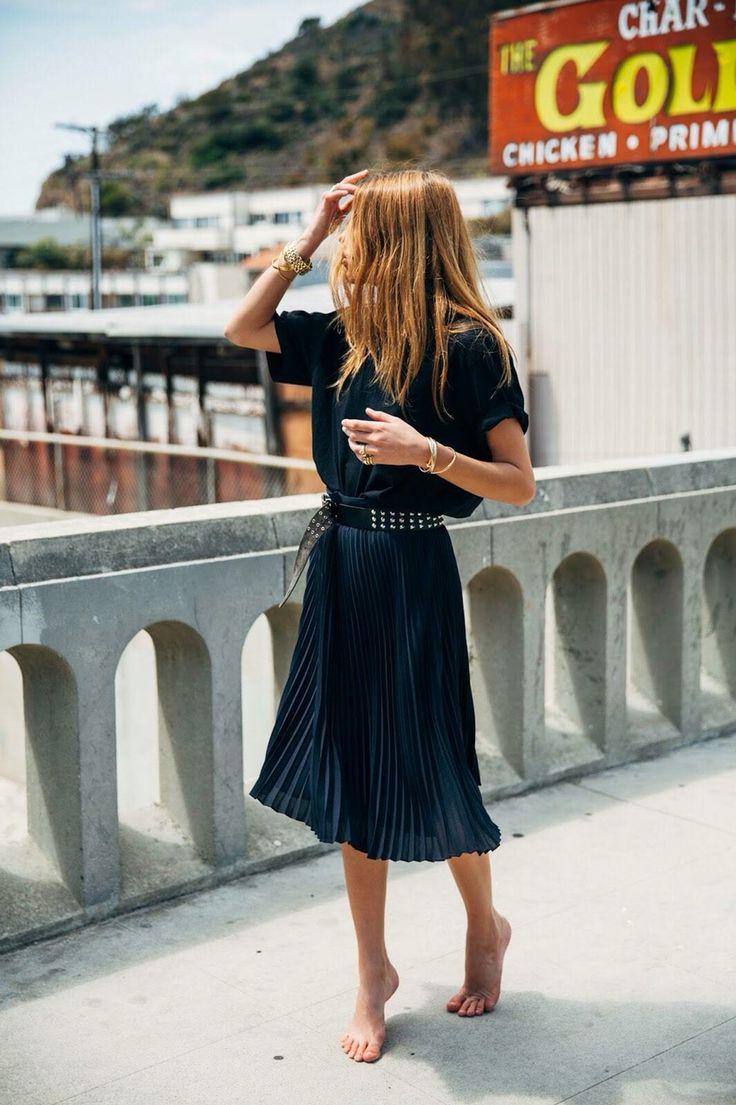Oversize black t-shirt, dark blue pleated skirt & studded belt | Maja Wyh | @styleminimalism
