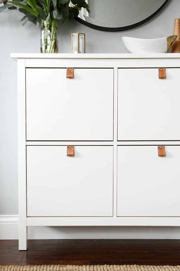 An easy and sophisticated Ikea hack, this DIY hack of the HEMNES cabinet calls for something you probably already have lying around the house: an old leather (or faux leather, like the one above!) belt. See how to make the luxurious-looking drawer pulls at House Tweaking.