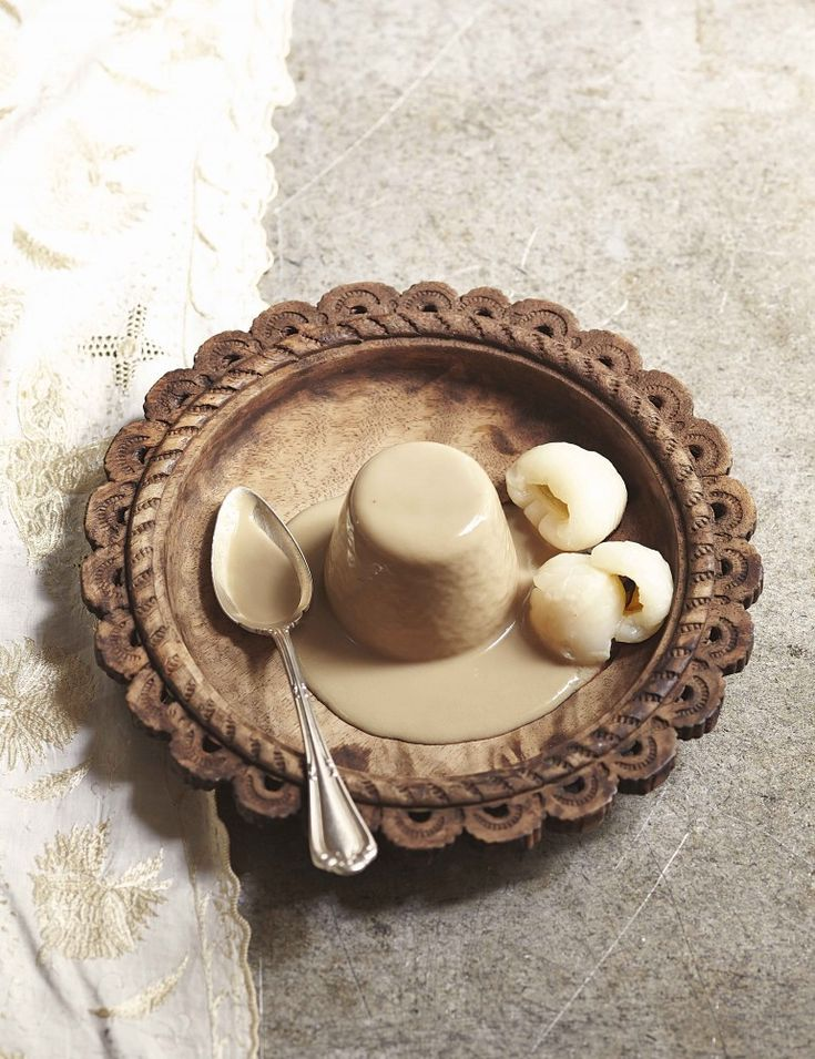 Liquorice and coconut panna cotta with lychees.