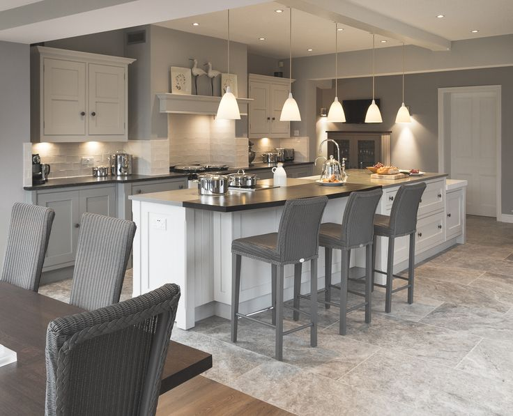 A bespoke shaker kitchen designed by Cheshire Furniture Company, featuring AGA, hand painted bespoke cabinetry, island unit with sink & induction hob.