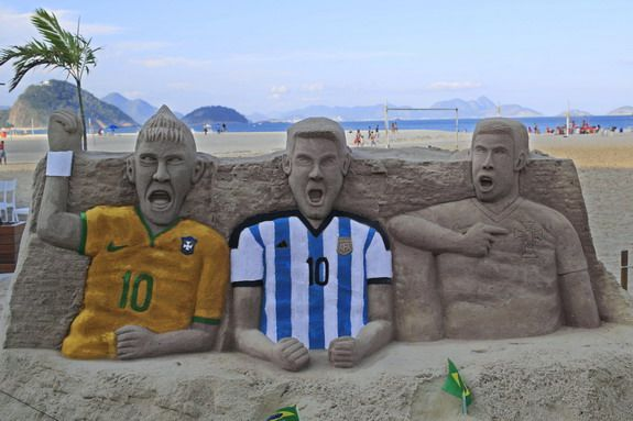 Caption This: Creepy sand sculptures of Neymar, Messi & Ronaldo at Copacabana beach