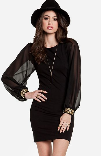 Mini dress featuring long, sheer chiffon sleeves with bejeweled knit cuffs. Unlined. Slips on over head.