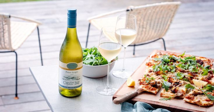 A recipe featuring an elevated pizza pairing. A white pizza with caramelized onions, pork & fennel sausage, crispy Brussel sprouts & fresh buffalo mozzarella. This pork and fennel pizza pairs perfectly with Oyster Bay Pinot Gris making for an extraordinary food and wine pairing.