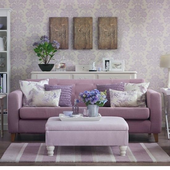 Love the mauve sofa, wallpaper and the tune-it-down rustic of the wall art. Very pretty.