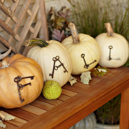 Use straight pins and antique keys to create a gorgeous fall display for your porch. More pretty front entry decor for fall: http://www.bhg.com/halloween/outdoor-decorations/pretty-front-entry-decorating-ideas-for-fall/#page=5