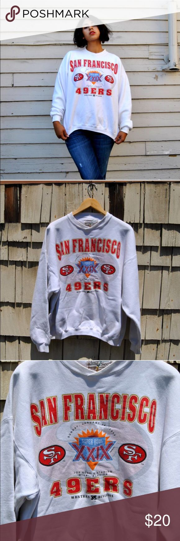 """90s 49ers Sweater GOLD BLOODED. Features Superbowl XXIX motif (29 for those who don't understand Roman numerals) from 1994. Great condition - There is some discoloration near the hem and a little fray on the left front, but otherwise great.  Found in: SF, CA  Brand: Galt Sand  Tag Size: L  Fits like a modern: Up to XXL  Model is 5'8"""" with measurements of 40x31x43, wears a modern size Large.  Measurements taken flat: Bust - 27in Length - 27in Sleeve - 22.5in Hips -    Material: 80 Cotton 20…"""