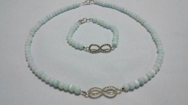 Collar y pulsera perlas y dije infinito con brillos. Facebook: Quiquen cosas lindas.  E-mail: quiquen_yo@yahoo.com.ar