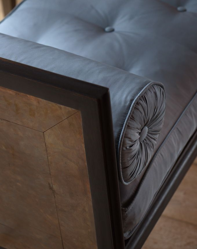 BB for Reschio - Detail of The Etruscan Window Seat - An ebonized oak and patinated bronze mounted window seat of neo-classical form, the cushion and bolsters covered in silk taffeta  - B.B. -     Drawn up in front of a fire, at the end of a bed or simply in front of a window. I love the contrast of the bronze panels and ebonized wood. Works very well in pairs. www.reschio.com