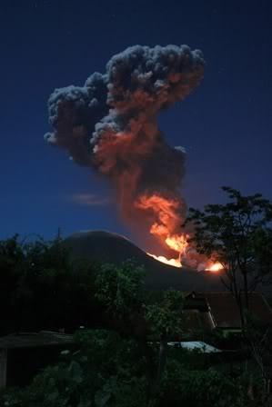 Mt Lokon volcano spews hot lava & volcanic ash during an eruption on 7/14/2011. N.Sula-wesi Province, ID. Berita Foto