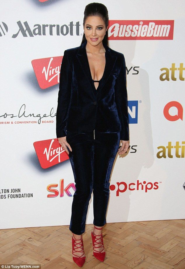 Busty display: Tulisa Contostavlos was on her best behaviour as she stepped out at the 2015 Attitude Awards on Wednesday night