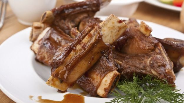 KASHMIRI STYLE MUTTON RIBS - How do you get the perfect crackling mutton ribs? Cook them in milk and spices, wrap them up in gram flour batter and fry them till they turn golden. Kashmir, India