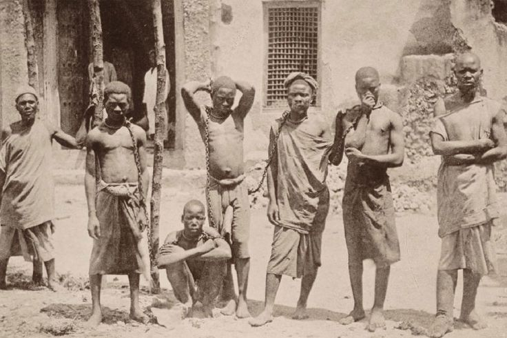 Young African slaves in shackles in what was known as German East ...