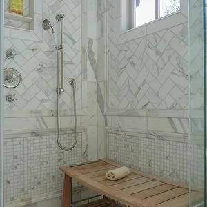 Fantastic Bathroom Shower Features Calcutta Gold Marble Herringbone Tiles As Well Niche