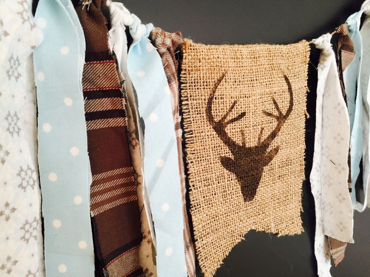 A personal favorite from my Etsy shop https://www.etsy.com/listing/219067548/woodland-nursery-rag-tie-burlap-banner