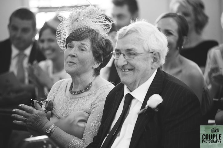 The groom's parents watch on as their son is married.Wedding at Summerhill House Hotel by Couple Photography.