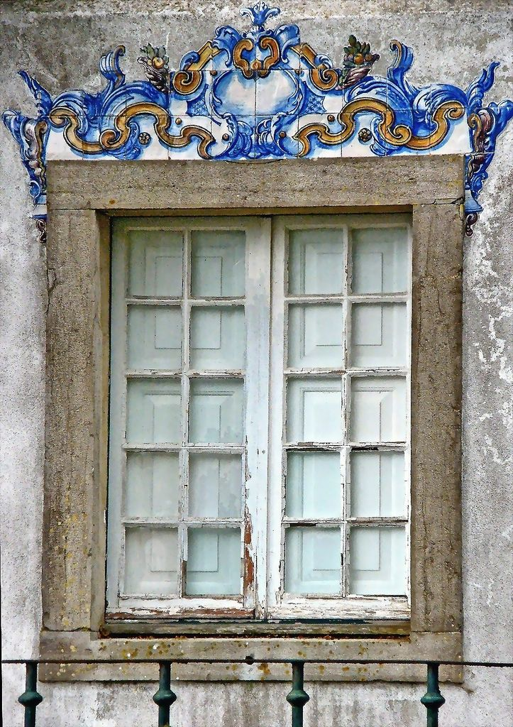 Portuguese window - Handmade tiles can be colour coordinated and customized re. shape, texture, pattern, etc. by ceramic design studios