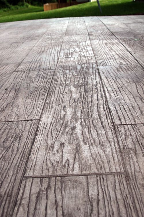 Stamped concrete to look like wood; great for patio or basement
