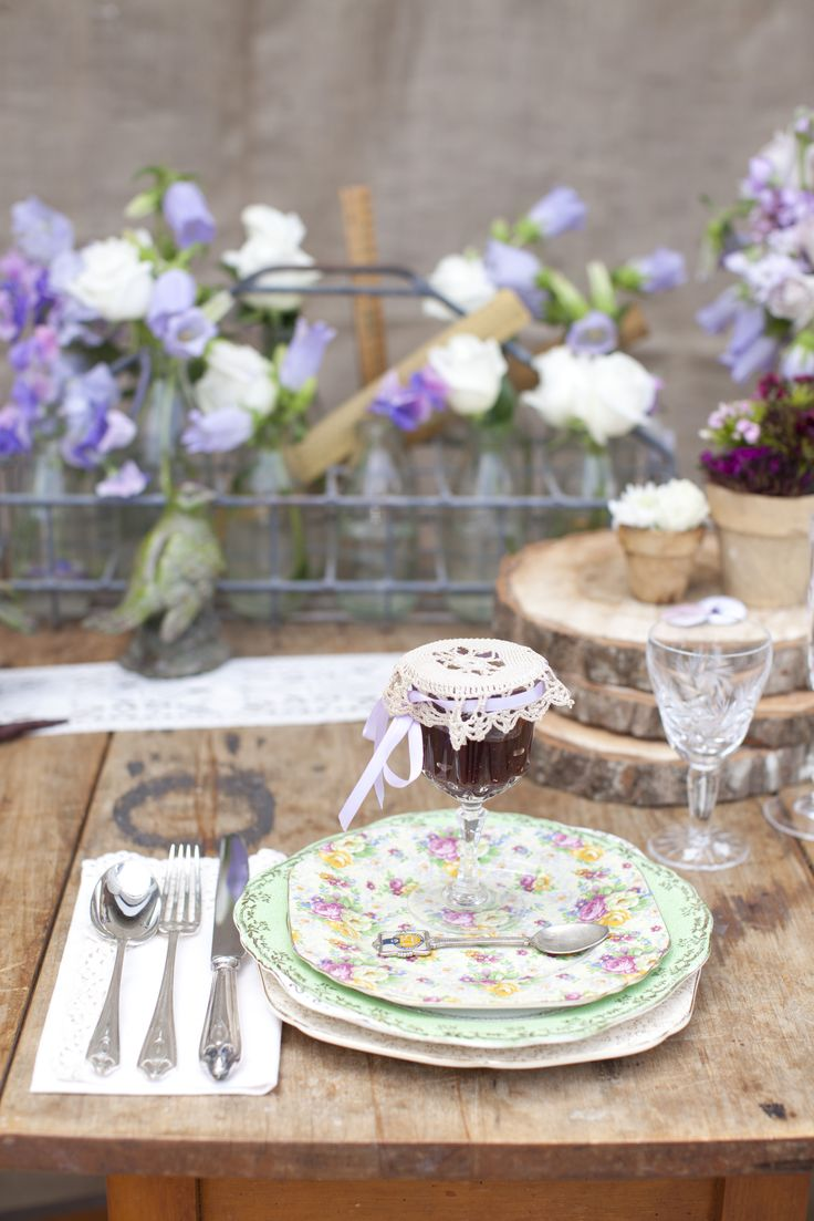 An eclectic range of vintage crockery brings a sense of nostalgia to table settings, while crystal glasses become treasured favours when filled with homemade preserves for guests to take home. New Zealand Weddings Magazine, Spring 2013 issue. Photography by Jimena Murray.