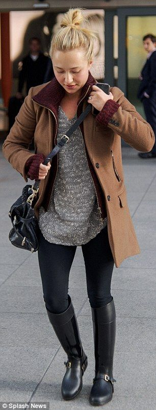 Keeping it casual: The actress looked stylish in black leggings and leather riding boots, paired with a simple beige sweater