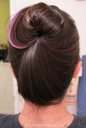 Create a bun without hairties, bobby pins, clips, or pencils.