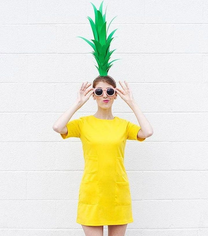 Green poster board and yellow clothing make for a great pineapple costume. #halloween #costume #ideas