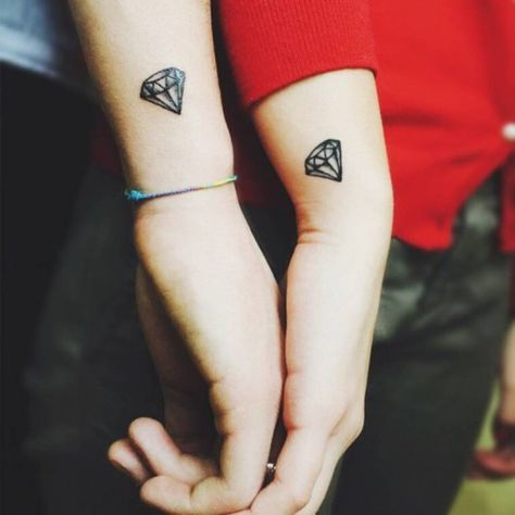 Matching diamond tattoos on Federica Fiore and her boyfriend.