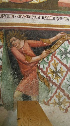 """""""ANDREA CARLONI, Chiesa di S. Orsola, Vigo di Cadore, 14th century"""" Actually 14th Century wall art from the Church of St. Ursula. Mural of man sneaking from behind wall cloths."