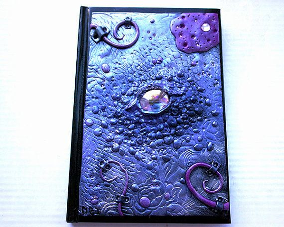 The dragon eye and swirls featured on the journal is hand crafted and detailed using polymer clay and mica powders. The journal is an A6 and can