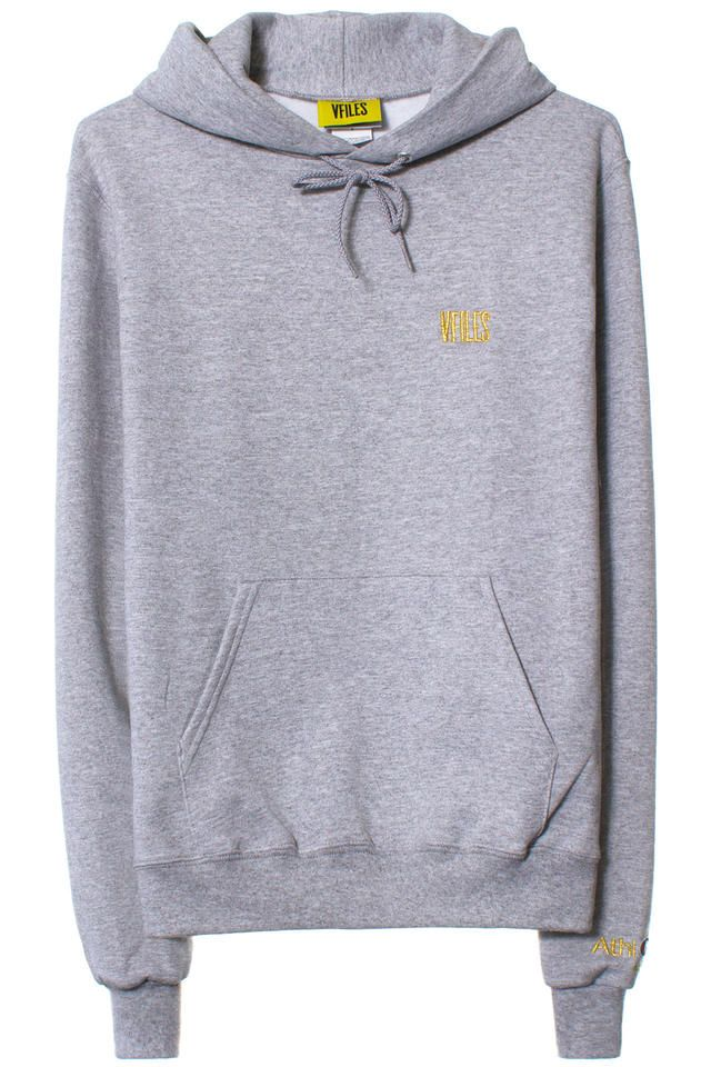 VFILES BASIC HOODIE| GREY-GOLD Grey hoodiefeaturing a goldVFILES logo on chest and Champion Athletic logo on sleeve. Made in Honduras. 100% Cotton. SIZE & FIT Standard unisex sizing. VFILES The VFILES line is a collection of VFILES-branded basics for all day, every day.