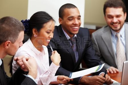 Multi ethnic business team at a meeting. Interacting. Focus on woman