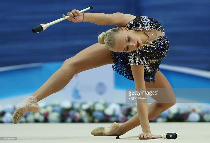 Russian rhythmic gymnast Yana Kudryavtseva performs her clubs routine during the Individual All-Around event at the 2016 FIG Rhythmic Gymnastics World Cup, at the Gymnastics Center in Kazan. Yegor Aleyev/TASS