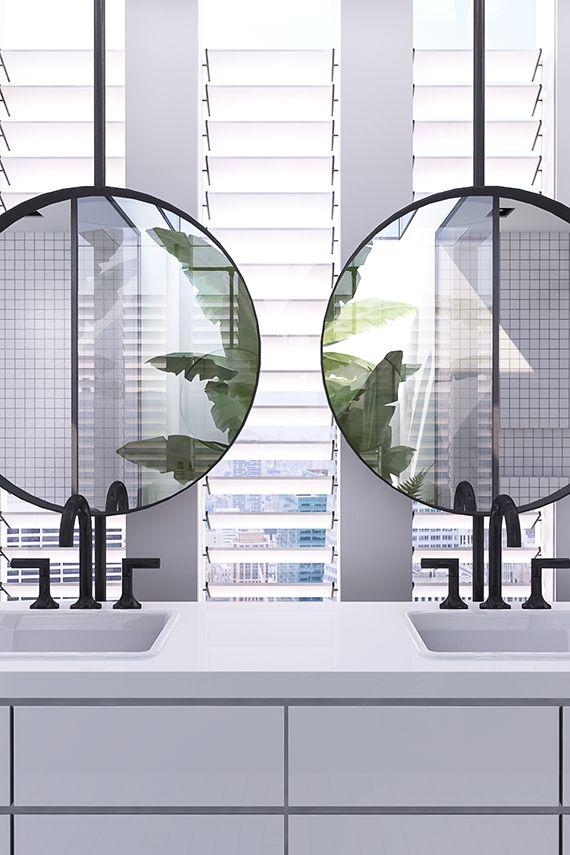 Double sink vanity with round mirrors | Urban contemporary bathroom. Design by Eleni Psyllaki @myparadissi
