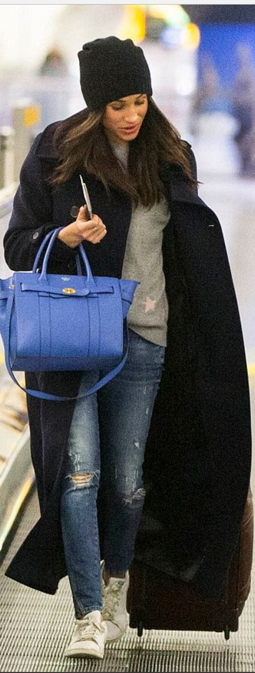 Who made Meghan Markle's gray star sweater, white sneakers, and blue handbag?