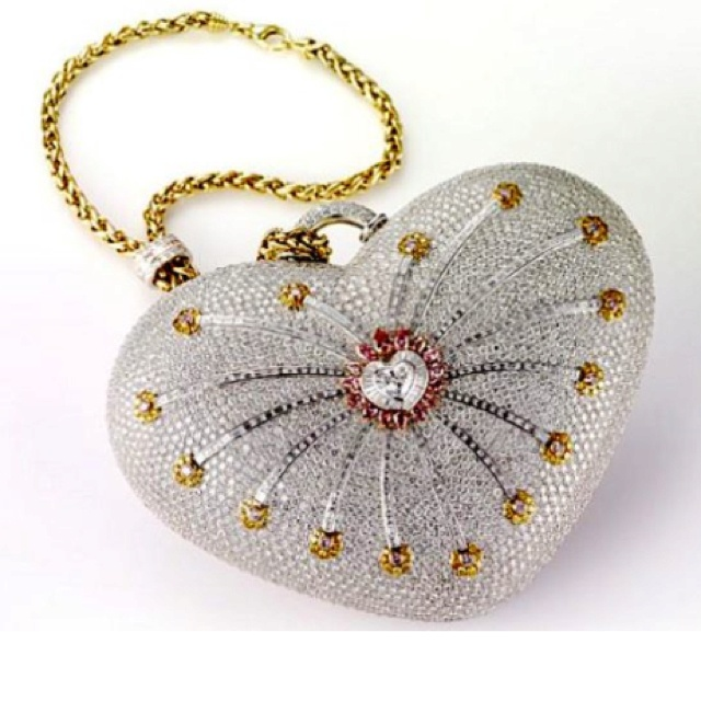 "Most expensive purse in the world ""The Mouawad 1001 Diamond Nights"" Crowned by the Guinness Book of World Records as the world's most expensive, the ""1001 Nights Diamond Purse"" is valued at $3.8 million. The heart-shaped bag is encrusted with more than 4,517 diamonds – 105 yellow, 56 pink and 4,356 colorless. The diamonds on the bag weigh a whopping total of 381.92 carats."