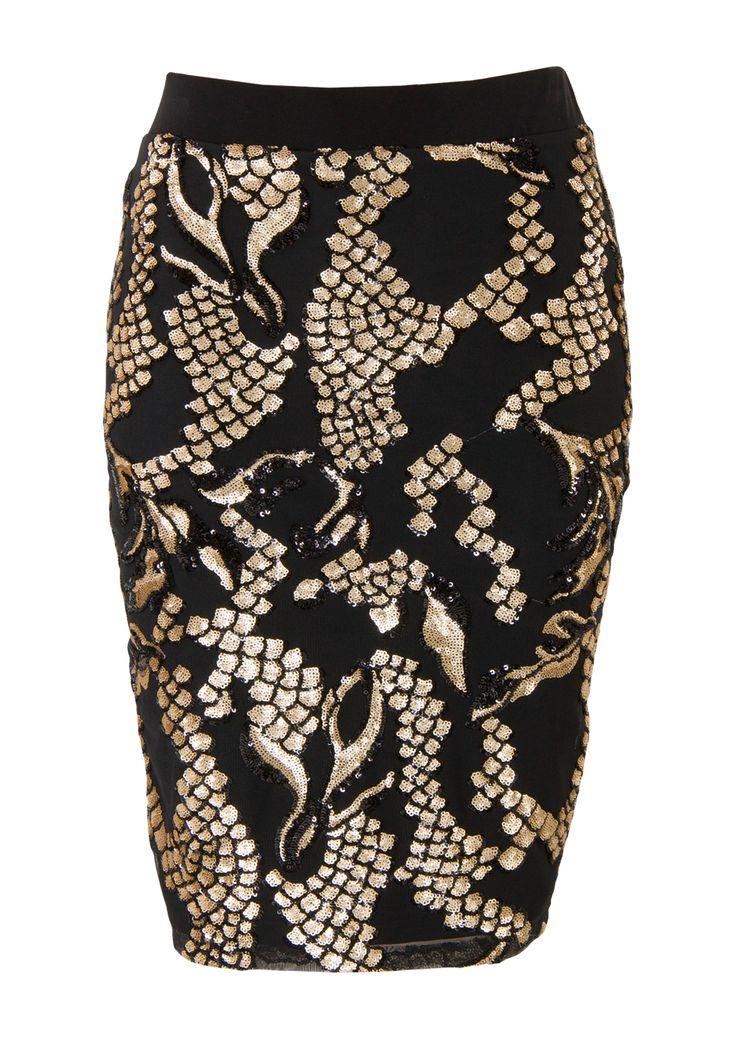 Zwarte rok met goudkleurige print en pailletten met een hoge taille. De achterkant is uni zwart. Het is een aansluitend model gemaakt van soepele kwaliteit. Knielengte.
