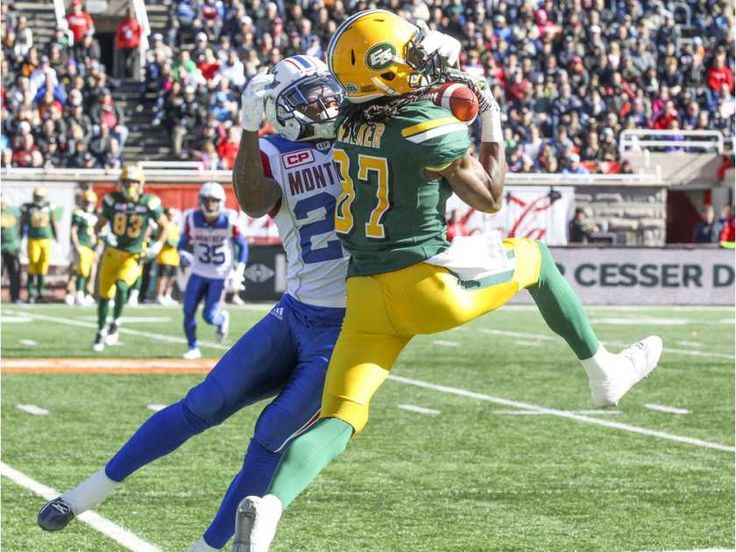 WK 16 - Edm.40 - Mtl.20 - Edmonton Eskimos' #87 Derel Walker makes a catch in front of Montreal Alouettes' #35 Greg Henderson during CFL action at Molson Stadium in Montreal on Monday, Oct. 10, 2016.