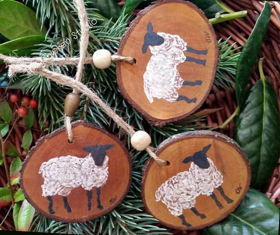 This beautiful farm ornament features a black faced sheep with white wooly fur hand painted on an oval wood slice. Shes a delight on the Christmas tree yet void of holiday themes to hang year round. Each of my farm ornaments are hand painted on an interesting wood slice that is cut to expose the bark for a natural appeal. The slices have been hand cut, washed, air dried, baked, painted & sealed.   A wonderful gift for farmers and sheep lovers including yourself!  ♦ Approximate measurement...
