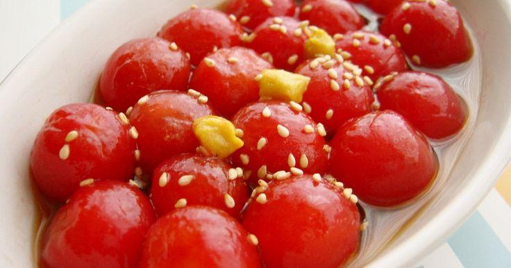 めんつゆとごま油でさっぱりドレッシング♪ 皮をむいたプチトマトに滲み込んで、とってもおいしいです!(^-^)ノ からしを添えても美味しいよ☆