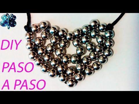 Como hacer un collar de bisuteria de cuentas o abalorios con forma de corazon de hilo - YouTube