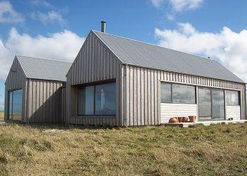 Dualchas Architects - Ardivachar Larch cladding, steel roof.  Much prefer vertical cladding.