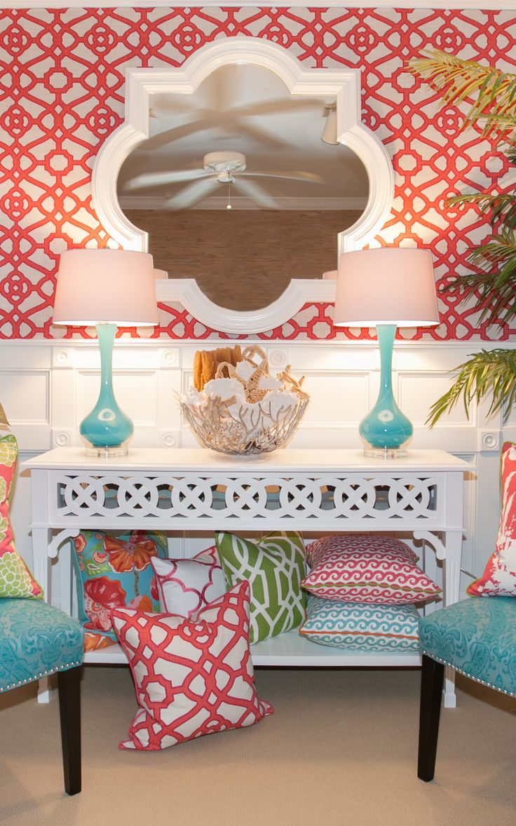 Palm Beach Sun Room: coral is coming of age. Twin with graphic patterns and teal and white accessories for a vibrant, elegant scheme.