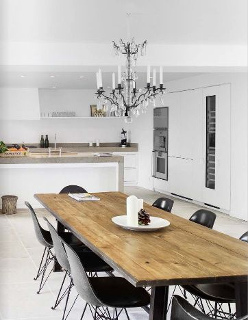 love the serene white with the graphic chairs + the natural wood table.