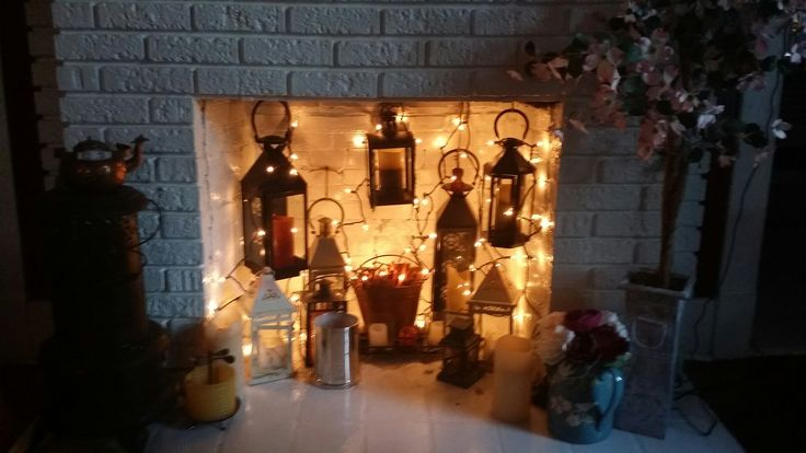 Hang Lanterns and lights into an unused fireplace                              …