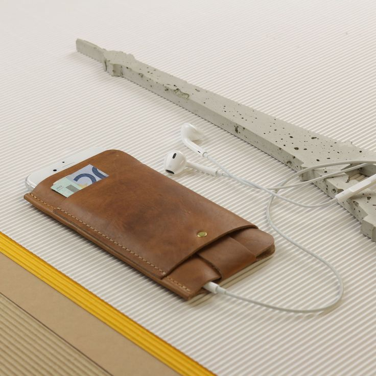 Slim Fit iPhone 6/6S & 6 Plus/6S Plus Sleeve Vintage Leather & Wallet Case The minimalist case for an 6/6S & 6 Plus/6S Plusmade from leather in a vintage-look was designed in the Hamburg Studio of Alexej Nagel and produced with great care by hand. Designed with a thin shape and very lightweight, yet protects your phone from potential impacts and scratches. The case is made from a single piece of leather that has been cut out, then folded and finally sewed together. On the front side the…