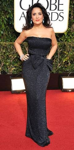 """Salma Hayek at the 2013 Golden Globe Awards. """"Salma is such a knockout! Her dress was very sophisticated and over-the-top glamour, so we wanted to play off the dress, but keep things hip. The eyes are very luminescent - we lightened them with coppers and silvery peach, then gave them depth with eggplant and plum. With a bright lip, the look was trendy, young, and modern."""" Makeup by Jeannia Robinette."""