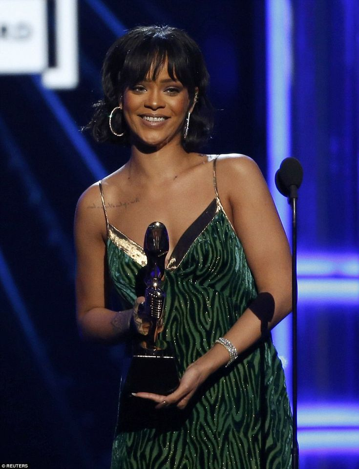 Big night: Rihanna took home the Billboard Chart Achievement Award, changing into a sparkly green number