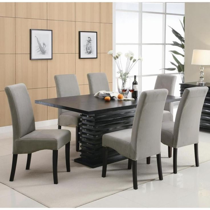 Reinvent your dining room décor with this contemporary seven piece table and chair set. The table in this set features a unique dazzling base that will impress your guests